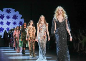 New York, NY, USA - February 13, 2016: Models walk the runway at the Monique Lhuillier runway show during of Fall/Winter 2016 New York Fashion Week at The Arc, Skylight at Moynihan Station, Manhattan.